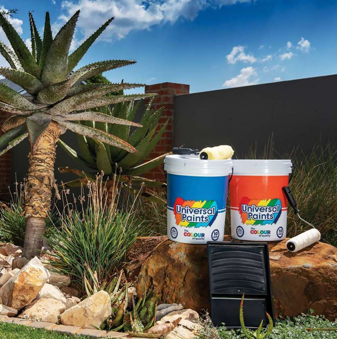 Universal Paints - Blue and Orange Bucket in the Garden
